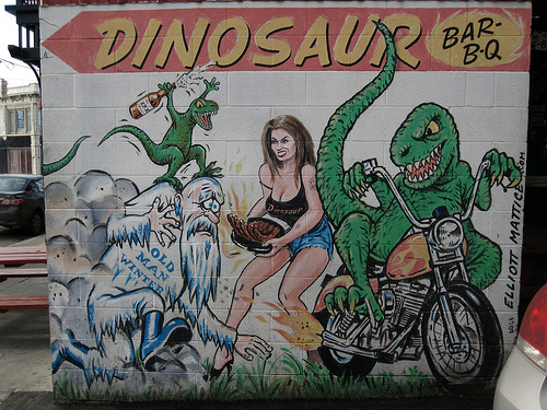 Is the waitress trying to save the dinosaur from winter with BBQ?
